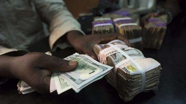 hand-holds-money