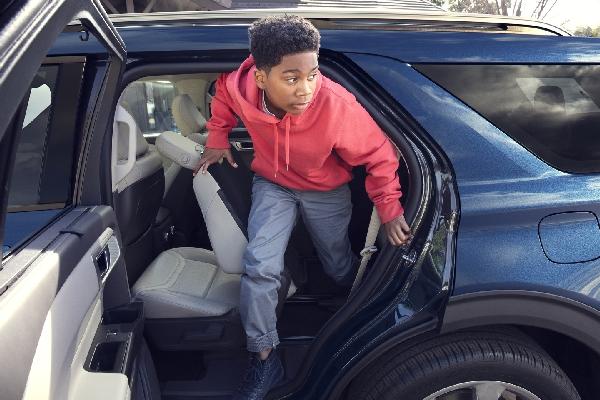 boy-coming-off-a-car