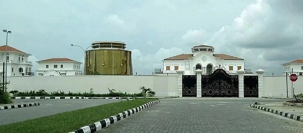 Front-gates-and-view-of-Adenuga-house