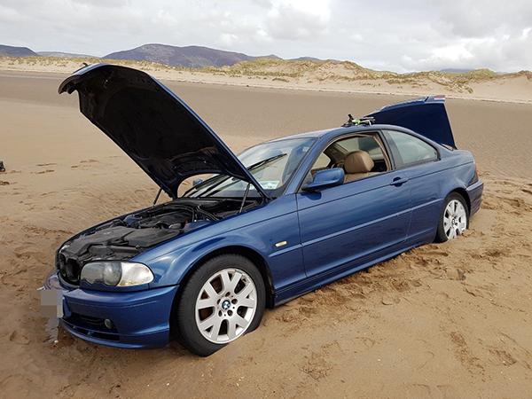 car-stuck-on-the-beach