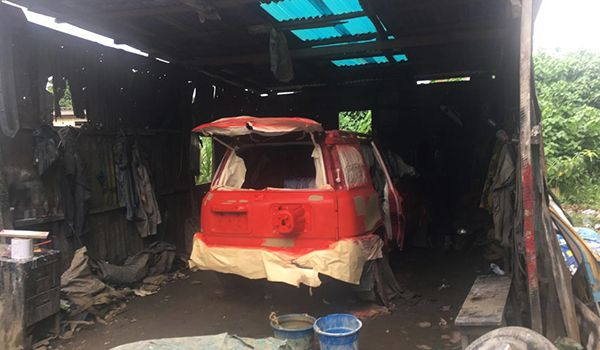 Local-car-painter-spraying-booth-in-Nigeria