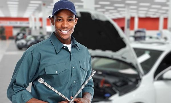 A-happy-mechanic-trainee-in-a-large-workshop