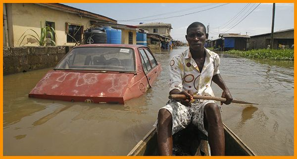 boat-on-flooded-road-in-Lagos-Nigeria