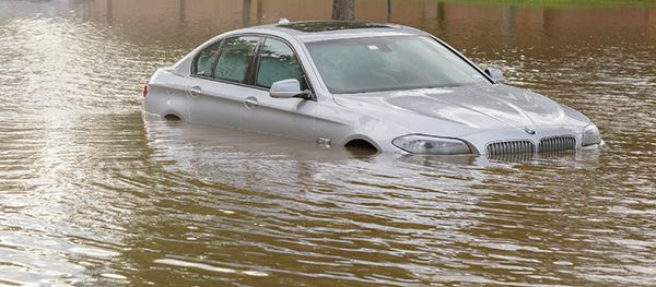 bmw-in-a-flooded-road-broken-down