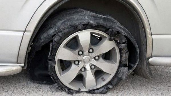 worn-out-tyre-on-a-car