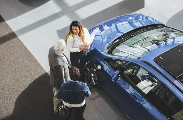 3-people-at-car-dealership