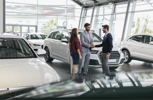 3-persons-at-car-dealer