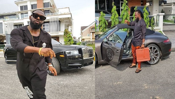Timaya-posing-with-his-expensive-cars
