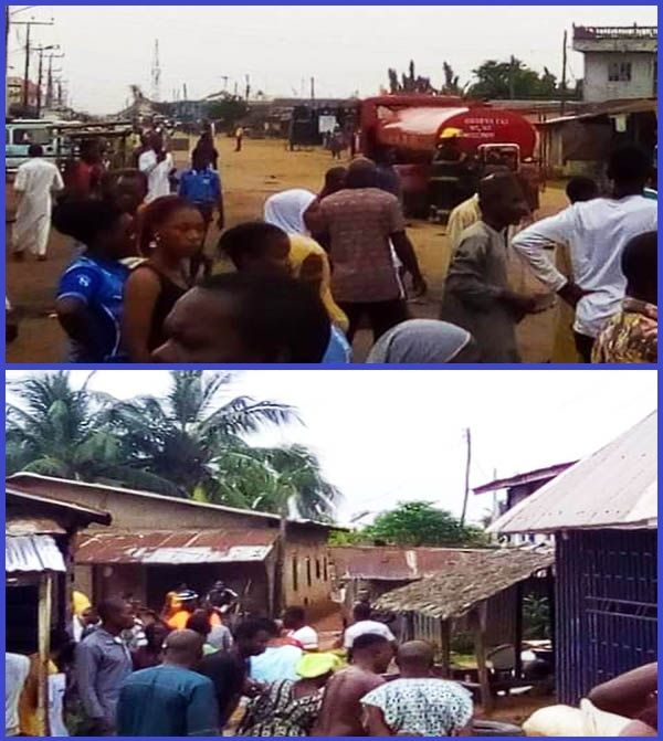 Resident-of-Badagry-community-in-Lagos-state-scoop-fuel-from-fallen-tanker
