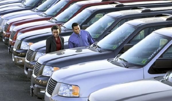 man-and-woman-look-at-cars