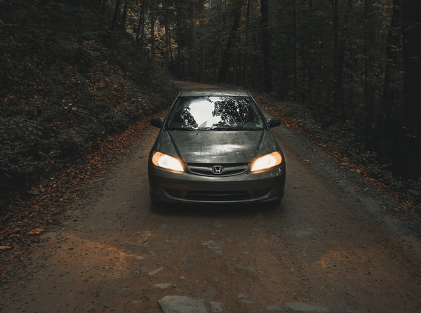 a-honda-civic-in-the-woods