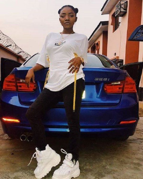 Simi-poses-with-her-BMW-3-SERIES