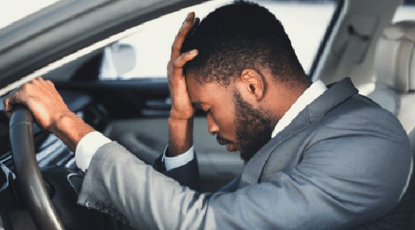 man-with-headache-while-driving