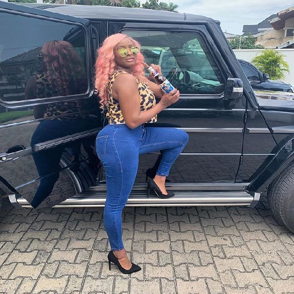 Cuppy-flaunting-the-g-wagon