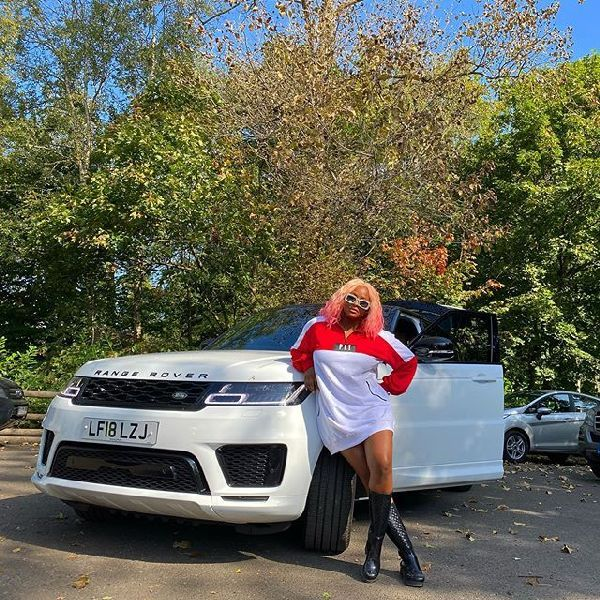 cuppy-posing-with-her-white-range-rover