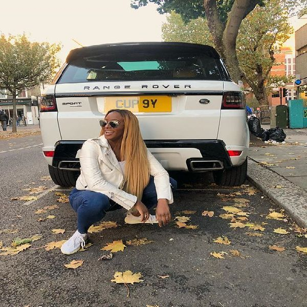cuppy-posing-at-the-back-of-her-white-range-rover
