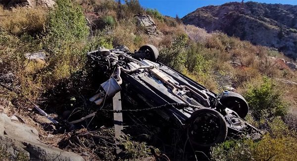 image-of-ford-mustang-rolled-off-mountain-road