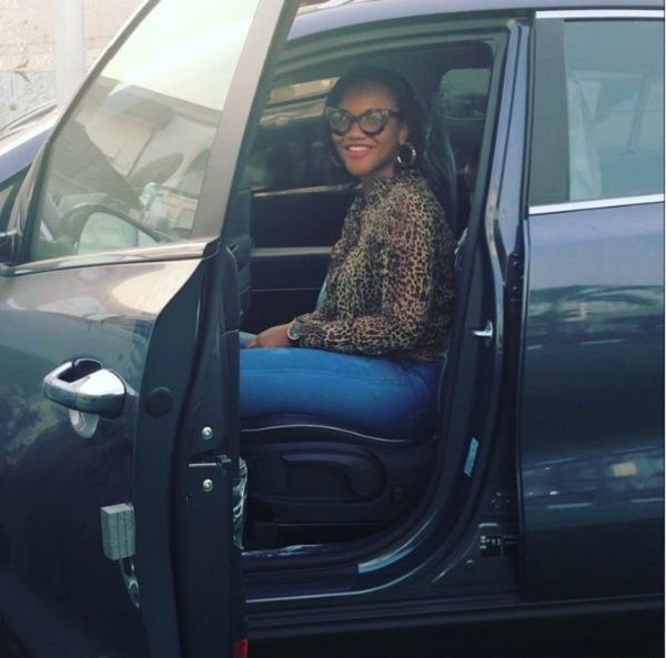 ada-ehi-in-car-smilling-back-at-the-photographer