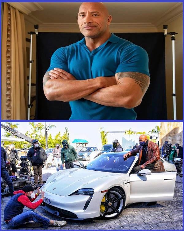 Dwayne-The-Rock-Johnson-poses-with-a-Porsche-Taycan-electric-sports-car