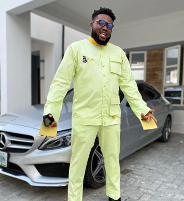 chinko-ekun-in-front-of-his-Mercedes-Benz