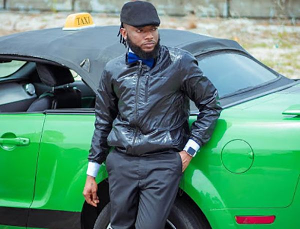 dremo-posing-with-his-green-car