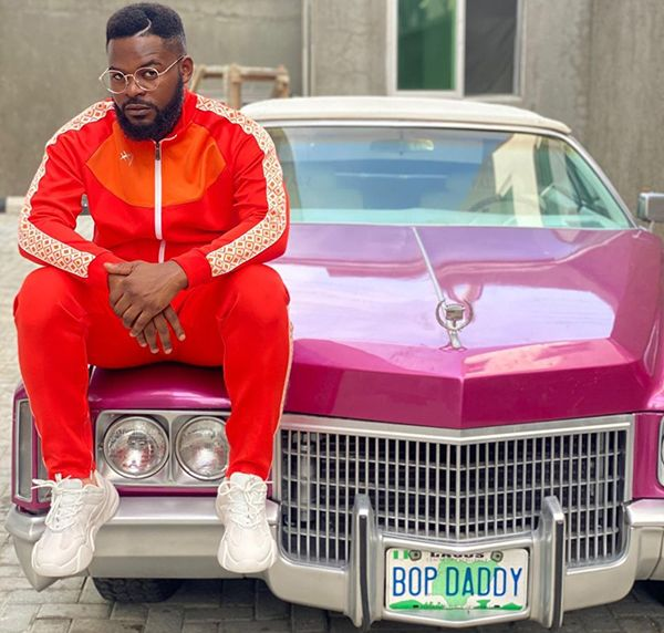 falz-sitting-on-his-pink-classic car
