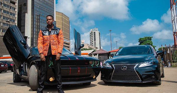 ladipoe-posing-with-his-cars