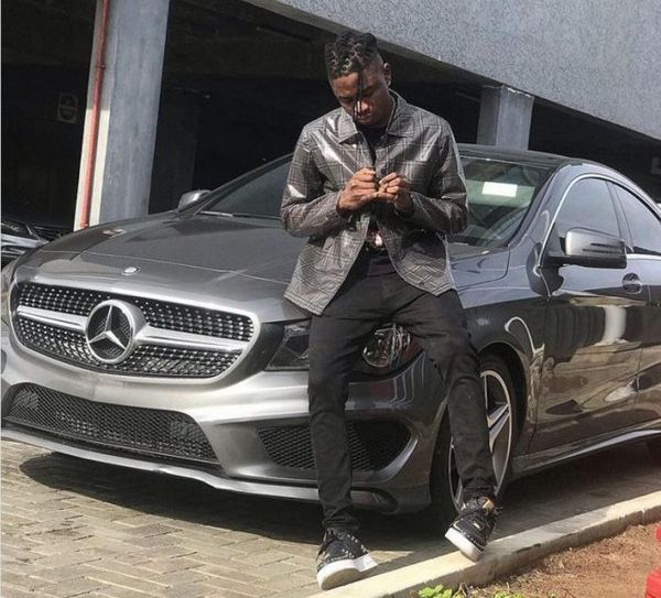 lil-kesh-taking-photo-with-his-Mercedes-Benz