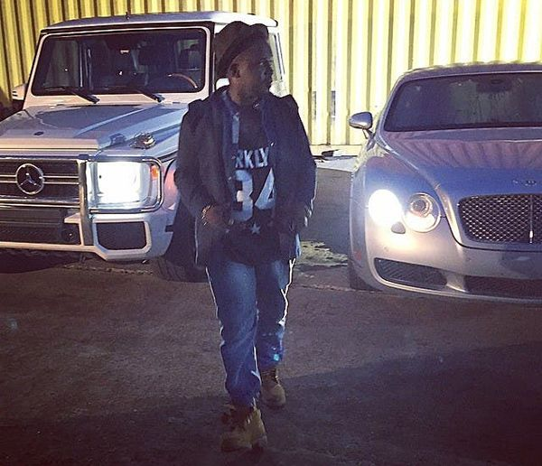 Rapper-M.I-posing-wiht-his-cars