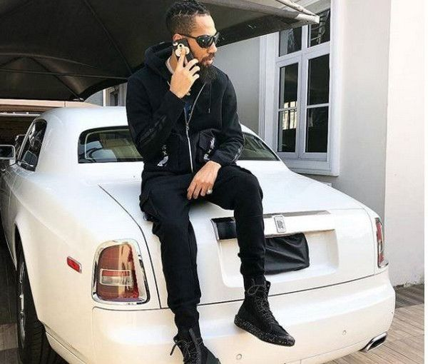 phyno-sitting-on-his-white-rolls-royce
