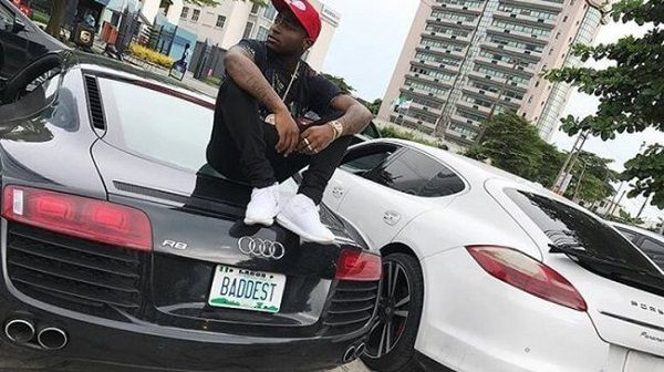 Photo-of-Davido-posing-with-his-luxury-cars