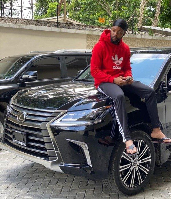 Flavour-Nabania-posing-with-his-Lexus-LX-570-SUV