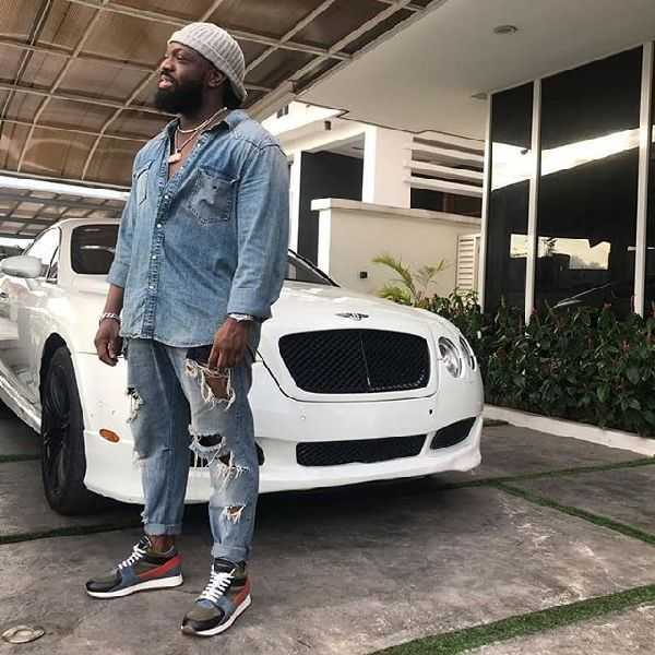 Music-star-Timaya-posing-with-his-Bentley-Continental-GT