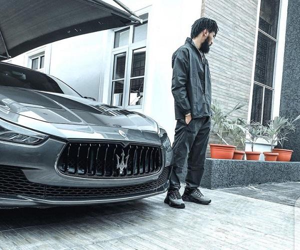 Nigerian-rap-artiste-Phyno-posing-with-his-luxury-car