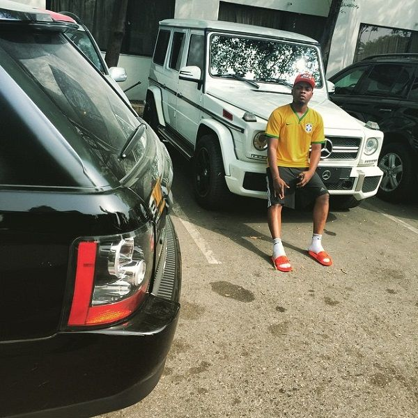 Nigerian-rapper-and-singer-Olamide-poses-with-his-Mercedes-G-Wagon-SUV