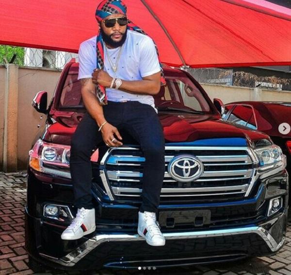 Popular-Nigerian-musician-KCee-posing-with-his-Toyota-Prado-SUV