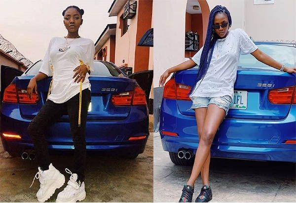 Popular-Singer-SIMI-posing-with-her-exotic-cars