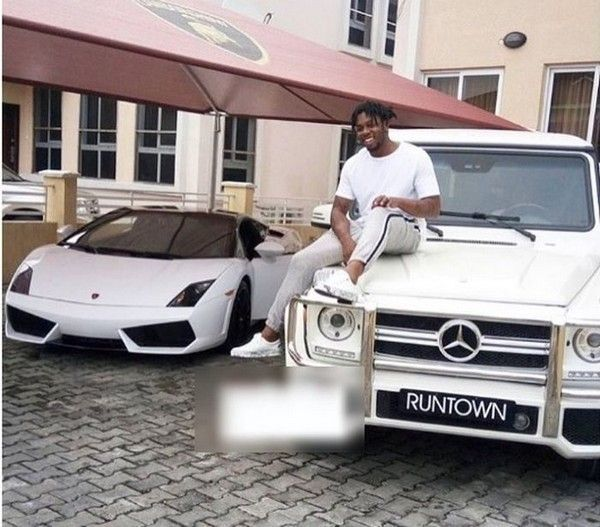 Runtown-posing-with-his-luxury-cars