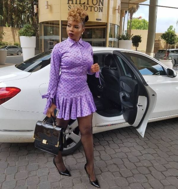 Yemi-Alade-posing-with-one-of-her-cars
