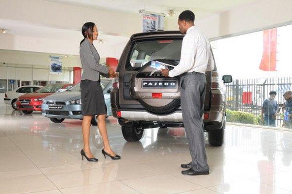 woman-and-man-at-car-showroom