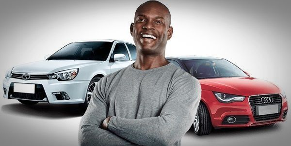 car-salesman-in-front-of-cars