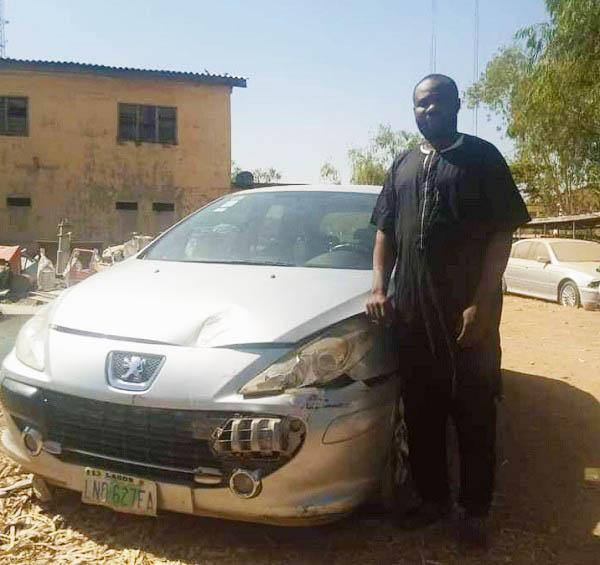 Photo-of-car-snatcher-Kiya-Peter-arrested-for-stealing-Peugeot-307-in-Adamawa