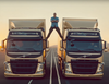 Volvo Trucks commercial features Jean-Claude Van Damme splitting between 2 reversing trucks