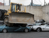 Heart-wrenching footage of 68 luxury cars being crushed as part of anti-smuggling combat