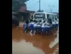 Catholic mothers captured pushing a bus on muddy roads in Anambra