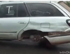 Impossible stunt! Driver cruises car with 3 tires, Nigerians react