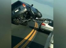 Ford Escape SUV tips over as its angry driver tries to hit a BMW