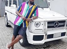 AY poses beside his white Mercedes Benz G-Wagon