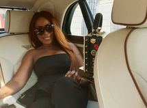 Linda Ikeji strikes a pose in her Bentley Mulsanne car