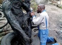 Condemned tyres? No look again! This artist see monumental pieces of art!